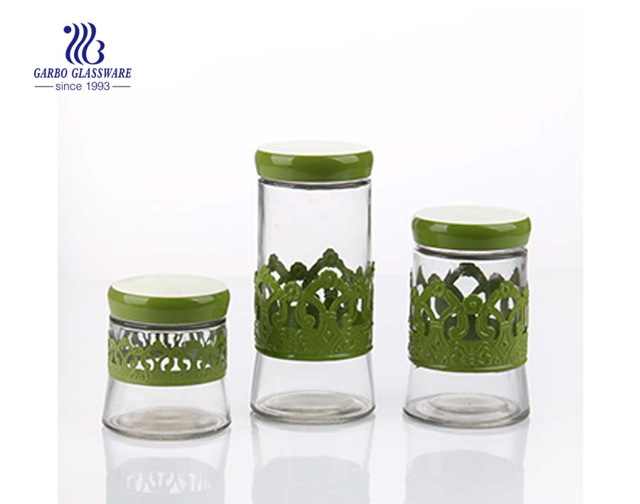 pretty glass storage jars with green decals