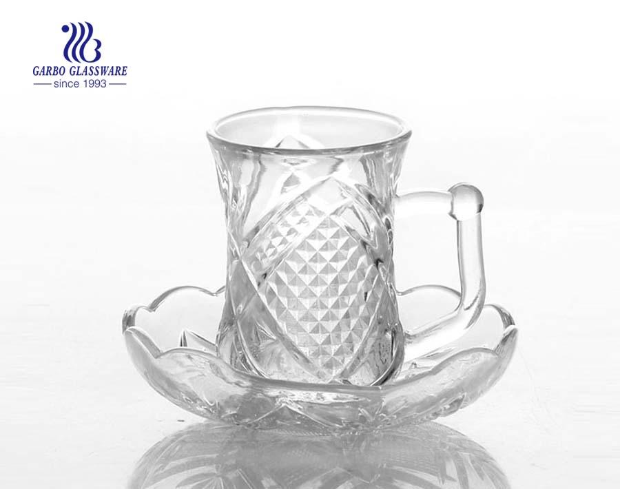 glass tea set with saucer and handle