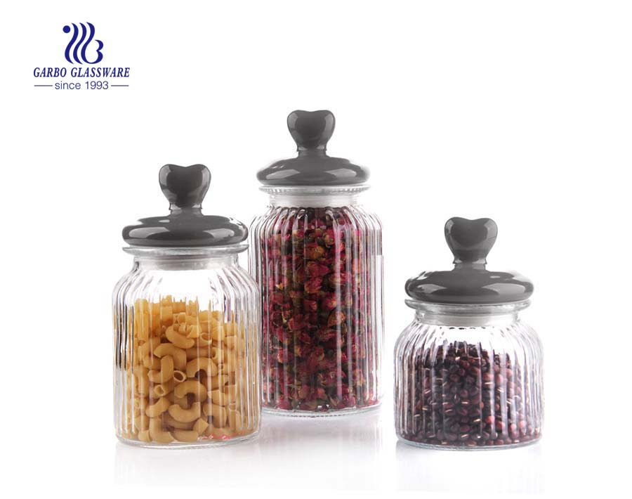 small glass candy storage jar with a gray lid