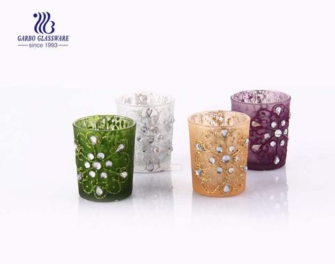 Castiçais de vidro plantados em E