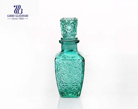 Jarra de vidrio de precio barato de 440 ml de color verde con tapa