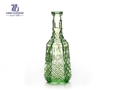 China por mayor de fábrica 1L jarra de vidrio de color verde con tapa