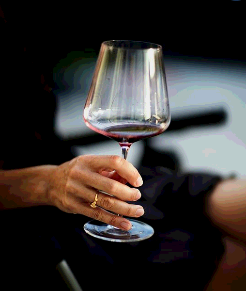 The correct way to hold the red wine glass