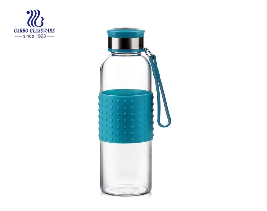 Venta caliente 350ml botella de agua de vidrio con tapa de color