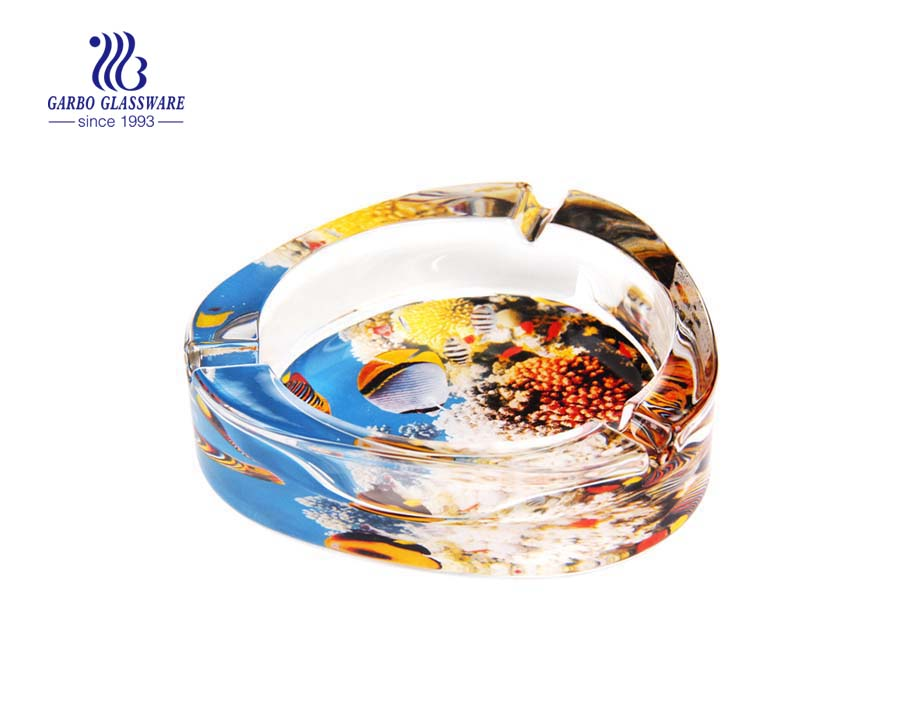 Amber color round glass ashtray for cigarette smoking