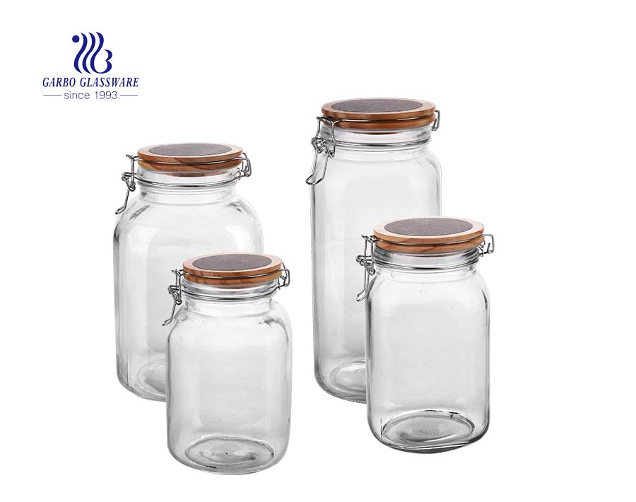 مجموعة من 4 عبوات مطبخ من الزجاج الشفاف محكم الإغلاق ومرطبانات تعليب مع أغطية تثبيت المحكم المحكم بكفالة (غطاء أحمر)