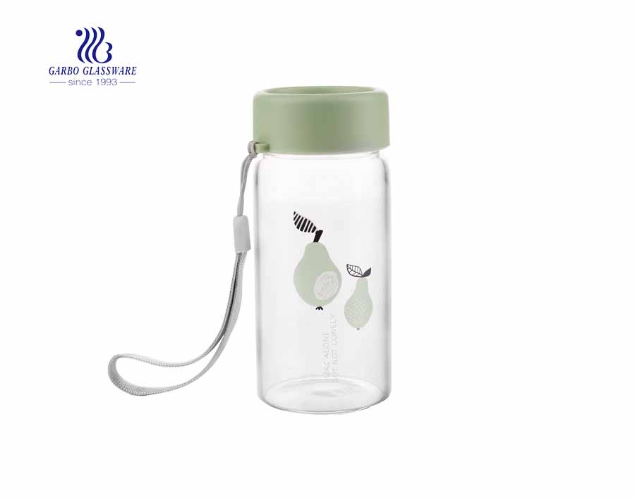 Daily use 260ml beverage clear glass drinking bottle with cover and string