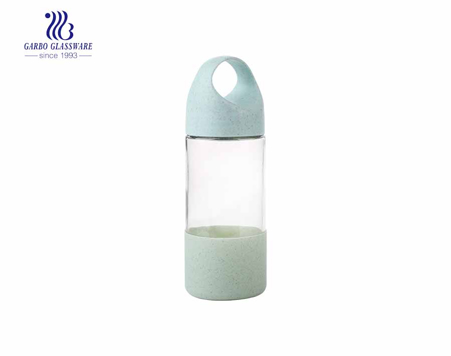 Wholesale cute design 380ml glass bottle with plastic sleeve and lid
