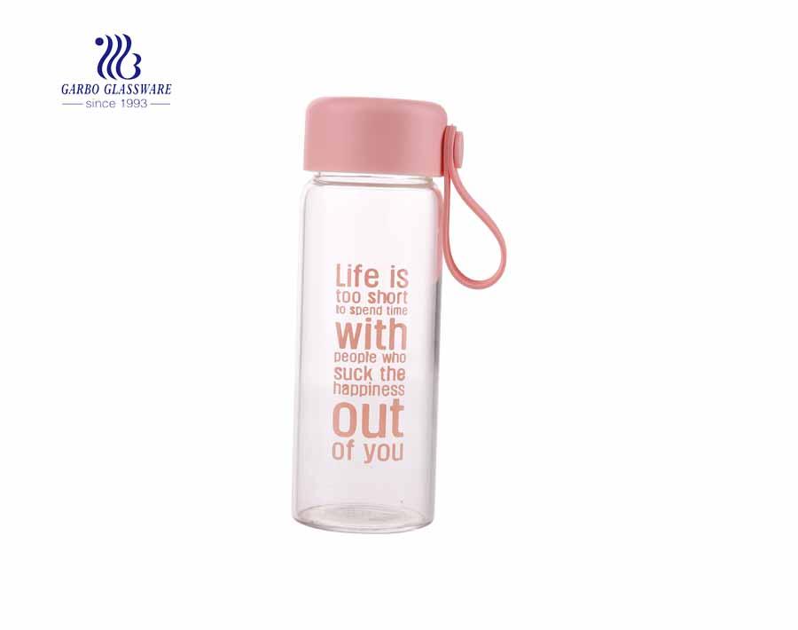 Botella de consumición al por mayor del vidrio del borosilicato del diseño 350ml del OEM con la tapa de bambú