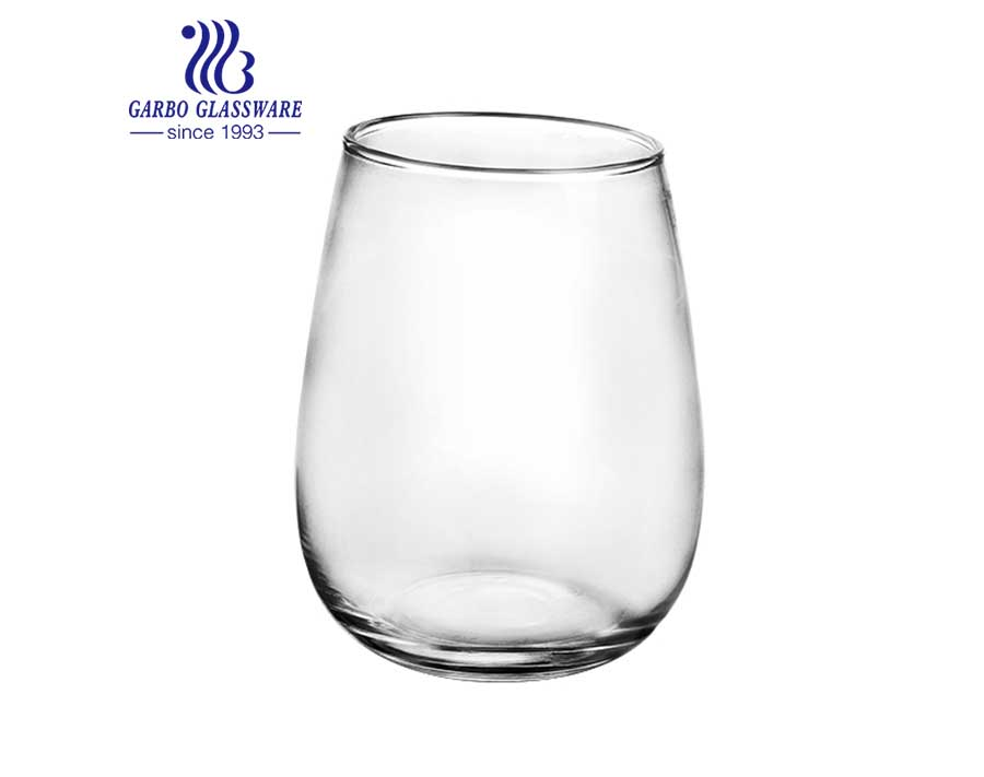 Ball shape round glass tumbler for juice and beverage in stock
