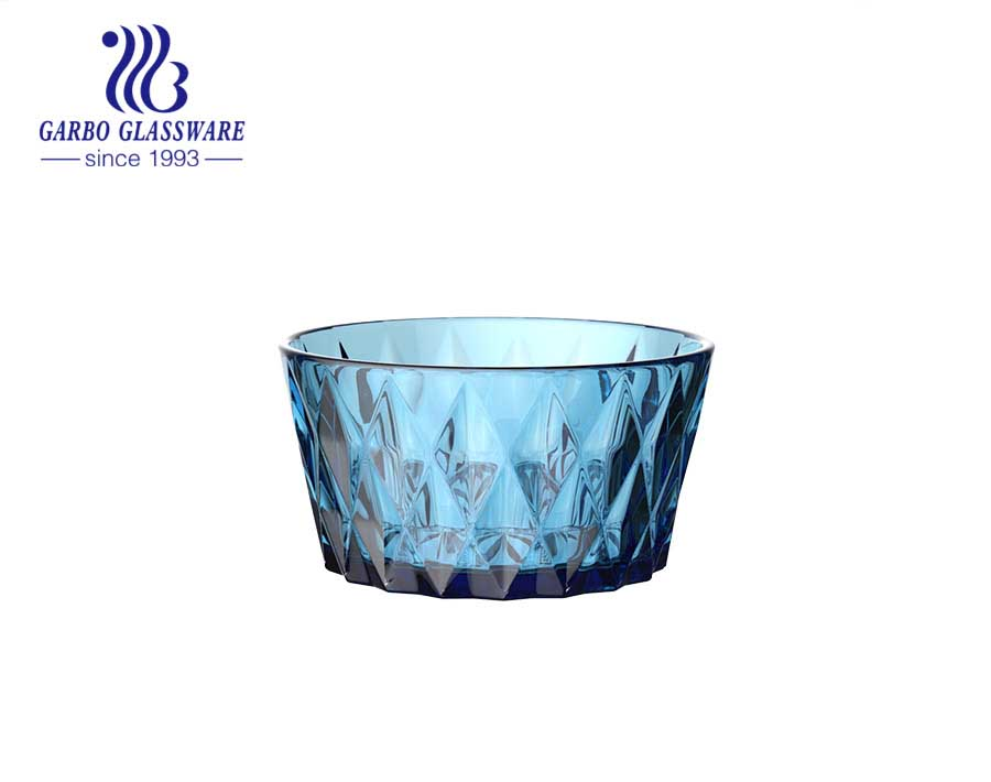 Dark blue solid color diamond pattern glass salad fruit bowl in the dinner table