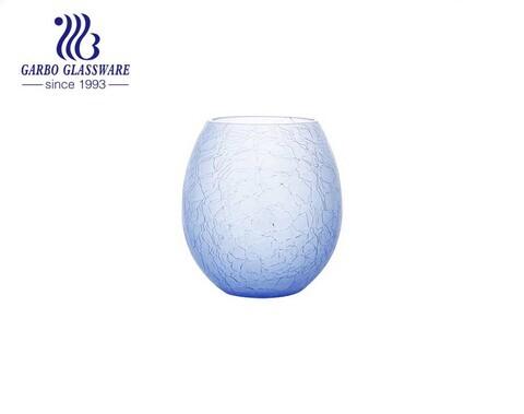 Forma de huevo azul Florero de vidrio de mesa especial Soporte de vidrio para flores Uso de banquete de boda