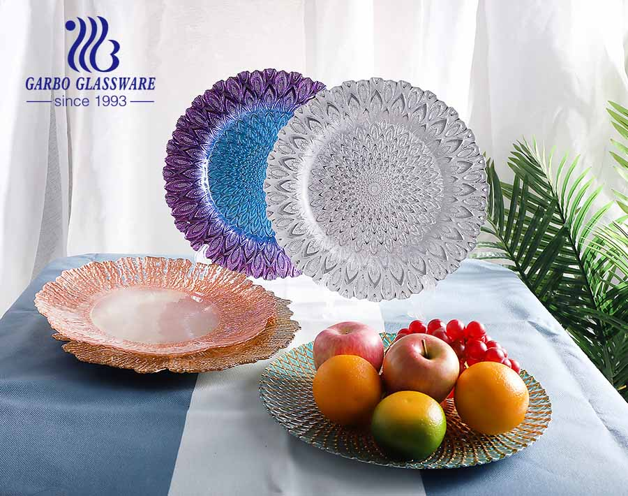 13 inch colored peacock design glass charger plates at dinner time