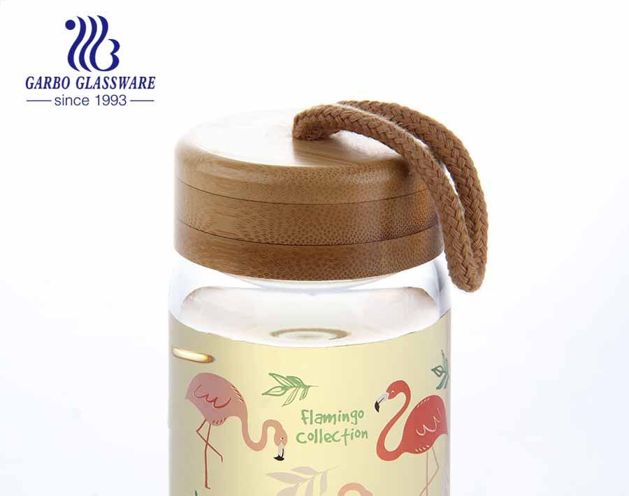 9 Unzen Flamigo Design Borosilikatglasflasche bleifreie Wasserspeicherflasche mit Bambusdeckel oder Stoffdeckel