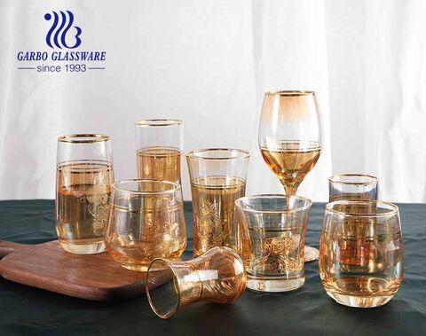 Juego de cristalería con revestimiento iónico dorado soplado a mano de estilo real, tazas de copa de vidrio con calcomanía personalizada y borde dorado con precio al por mayor