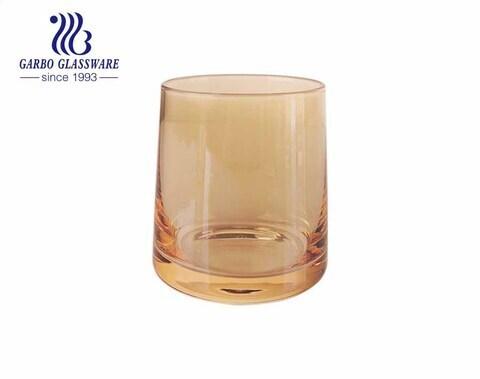 Vaso de vidrio soplado hecho a mano de 9 oz con galvanoplastia de iones inmarcesibles colores dorado e iridiscente