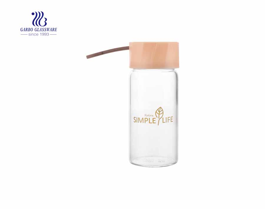 Lead free 500 ml sporty  bottle borosilicate glass lead free bottle with lid for hot and cold water juice