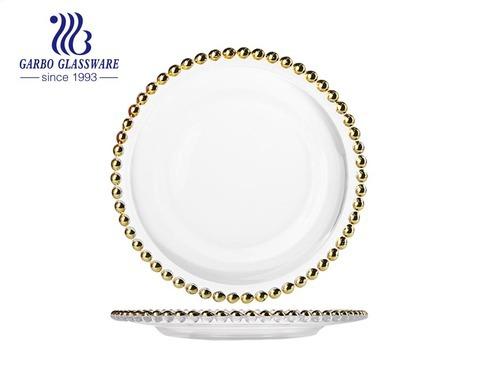 高級ロイヤルホテルウェディングダイニング装飾ガラス食器10.6インチ充電器ゴールドリムとビーズ装飾ガラスプレート